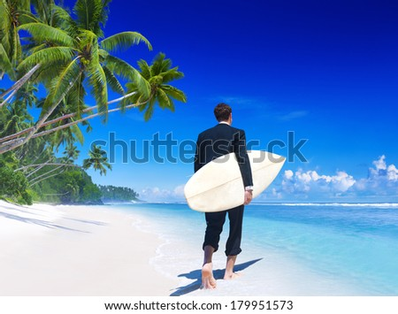 Businessman With Surfboard On Tropical Beach - stock photo