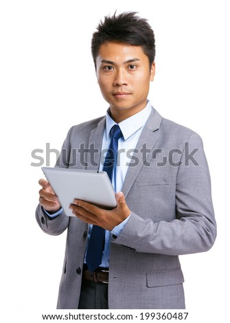 Businessman with tablet - stock photo