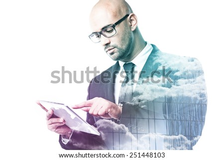 Businessman with tablet double exposure with sky and glass facade isolated on white - stock photo