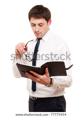 Businessman  with tablet pc. Isolated over white. Focused on hand with reader. - stock photo