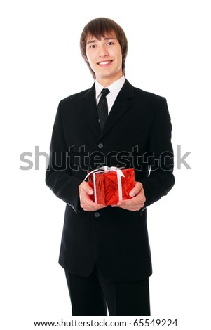 businessman with the red gift. Isolated at white background - stock photo