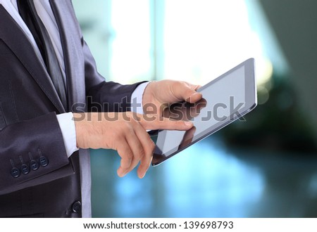 Businessman with the tablet. - stock photo