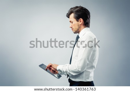 businessman with touch pad - stock photo