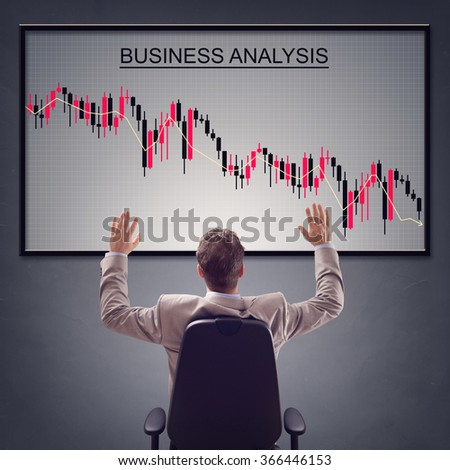 Businessman with trading stock market in economic crisis and line graph showing negative trend decline - stock photo