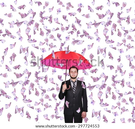 businessman with umbrella and falling 500 euro banknote - stock photo