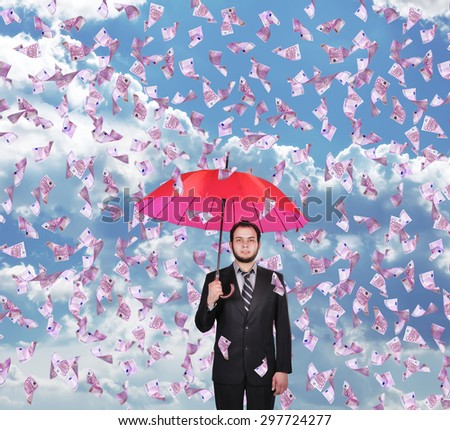 businessman with umbrella and falling 500 euro bills - stock photo