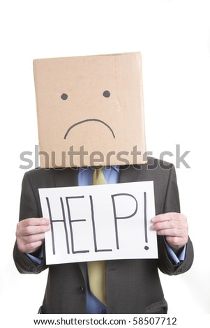 Businessman with unhappy box face - stock photo