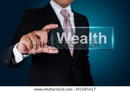 Businessman with wealth text label. - stock photo