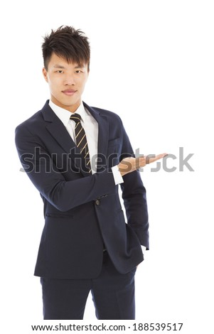 businessman with welcome and showing gesture - stock photo