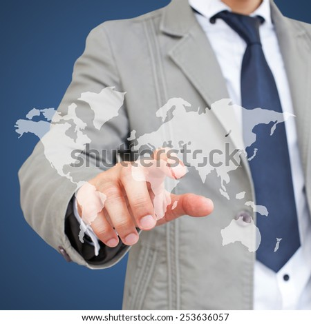 Businessman with world map - stock photo