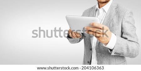 Businessman working a tablet PC -Clipping Path - stock photo