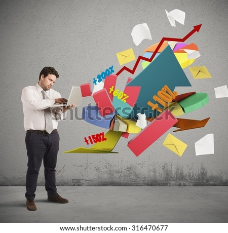 Businessman working at computer graphs and percentages - stock photo