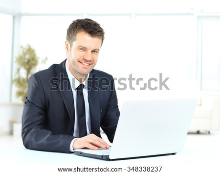 businessman working at the computer - stock photo