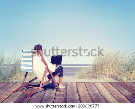 Businessman Working by the Beach - stock photo