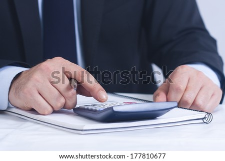 Businessman working in the office in the foreground - stock photo