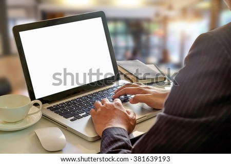businessman working laptop on the office table at office. vintage effect.morning light - stock photo