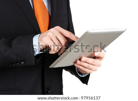 Businessman working on a digital tablet isolated on white - stock photo
