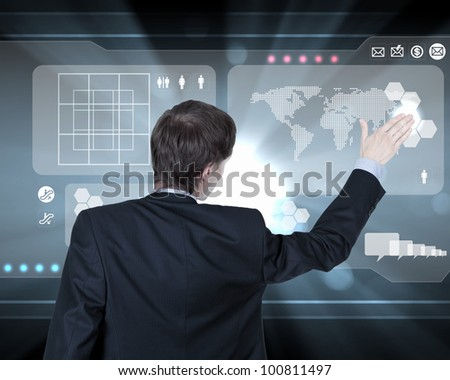 Businessman working on a virtual digital keyboard - stock photo