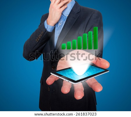 Businessman working on chart, business concept.Touch-pad visual screen. Isolated on blue. Stock Photo - stock photo
