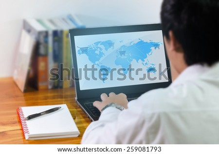 Businessman working on computer - stock photo