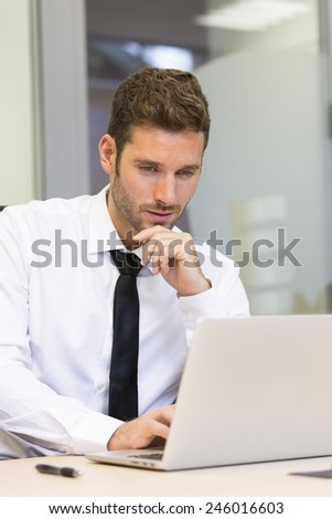 Businessman working on computer in modern office - stock photo