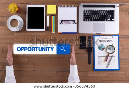 Businessman working on desk - OPPORTUNITY concept - stock photo