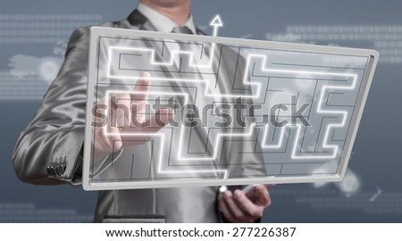 businessman working on digital screen of maze, business strategy concept - stock photo