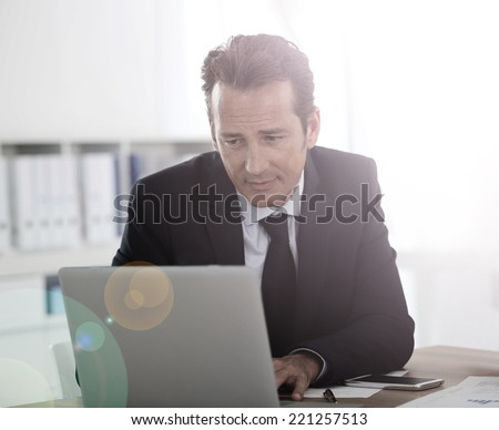 Businessman working on laptop computer - stock photo