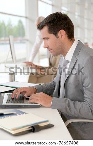 Businessman working on laptop computer - stock photo