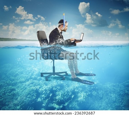 Businessman working on vacation even at sea - stock photo