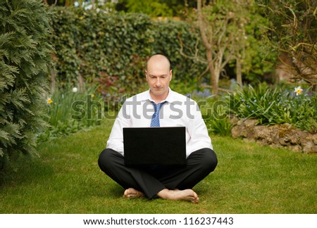 Businessman working outdoors - stock photo