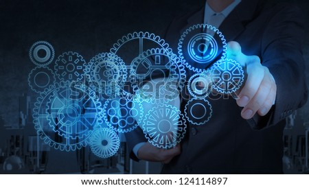 businessman working with blue light gear to success as concept - stock photo