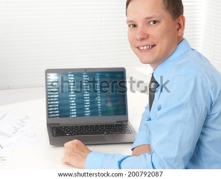 businessman working with his laptop at desk - stock photo