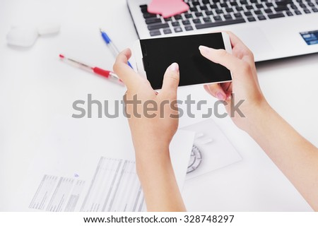 Businessman working with smartphone in offce.  - stock photo