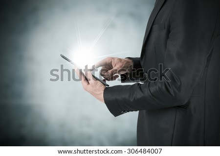 businessman working with tablet - stock photo