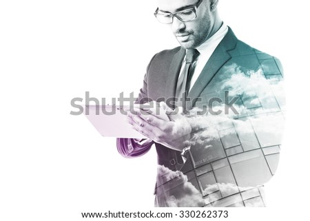 Businessman working with touch pad isolated on white - stock photo
