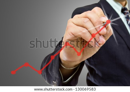 Businessman write graph business for explain something - stock photo