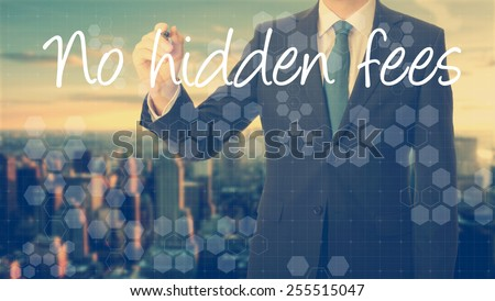 businessman write on transparent board No hidden fees with sunset over the city in the background, the sun's rays falling into lens are symbolizing the good attitude - stock photo