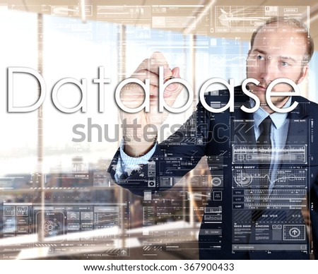 businessman writes on board text: Database - with sunset over the city in the background, the visible sun's rays in a picture are symbolizing the positive attitude - stock photo