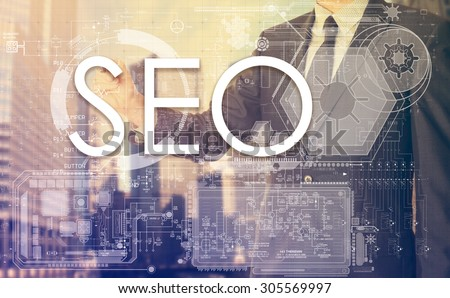 businessman writes on board text: SEO - with sunset over the city in the background, the visible sun's rays in a picture are symbolizing the positive attitude - stock photo
