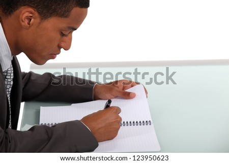 Businessman writing a document - stock photo
