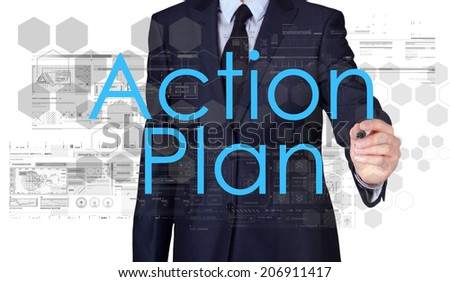 businessman writing Action Plan and drawing some sketches  - stock photo