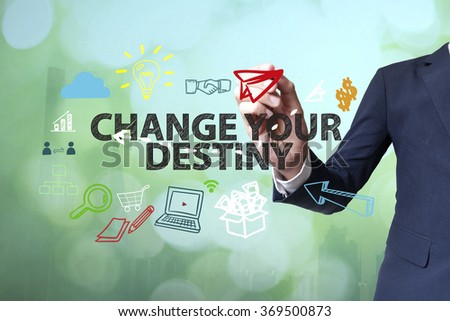 Businessman writing and drawing CHANGE YOUR DESTINY concept on blurred abstract background , business concept , business idea - stock photo
