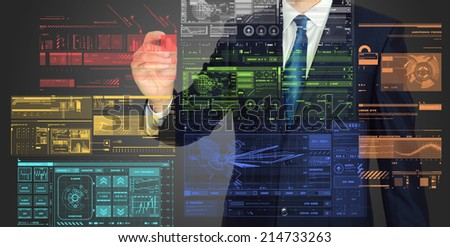 businessman writing and drawing graphs and diagrams on grey background  - stock photo