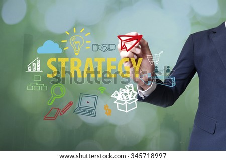Businessman writing and drawing strategy concept on blurred abstract background , business concept  - stock photo