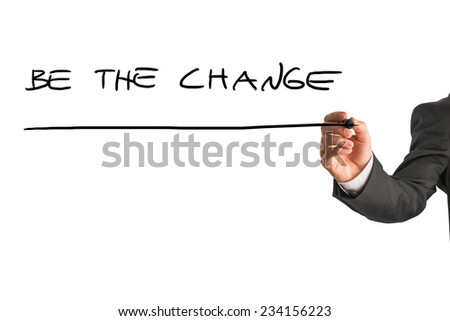 Businessman writing - Be the change - with a black marker pen on a virtual screen over white with plenty of copyspace in an inspirational concept. - stock photo