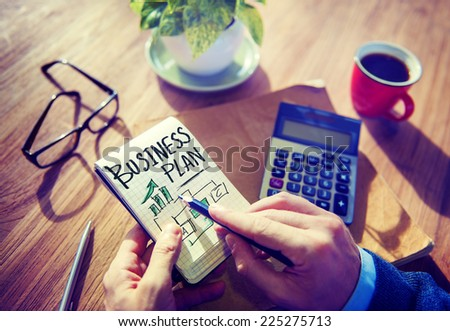 Businessman Writing Business Plan Growth Concept - stock photo