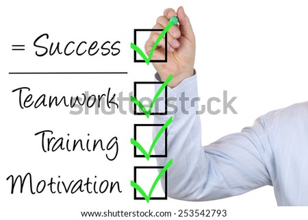 Businessman writing business success concept with teamwork, training and motivation - stock photo