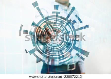 Businessman Writing Circle Graphics. - stock photo