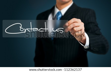 businessman writing contact us  on a  screen - stock photo